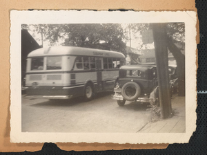 Photograph of a bus and automobiles