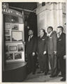 Richard J. Daley and three men view a Chicago Defender display