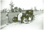 Repairing tire on road near Knowlton Plantation, Perthshire, Mississippi Delta, Mississippi, October 1939