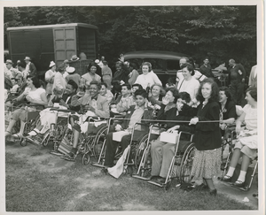 Wheelchair users watch event