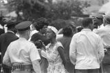 African American woman speaking to a police officer in the street after the bombing of 16th Street Baptist Church in Birmingham, Alabama.