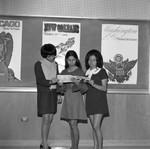 Women look at Brochure, Los Angeles, 1971