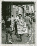 Daisy Bates takes a walk - Activist Daisy Bates picketing with placard