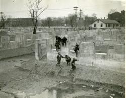 African-American boys playing among foundations of new Brewster Housing Project, Detroit, MI 5 April 1937