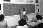 Career Day lecturer in a classroom, Los Angeles, 1985