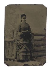 Tintype of woman in jacket and dress with hat and muff