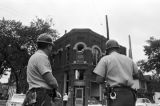 Police officers standing in the street after the bombing of 16th Street Baptist Church in Birmingham, Alabama.