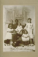 African-American woman with white children, books and toys, South Norwalk