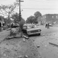 Damaged car and debris in the street after the bombing of 16th Street Baptist Church in Birmingham, Alabama.