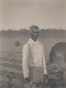 Man in White Shirt in Field