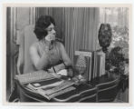 Elreta Alexander at her desk