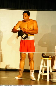 Vincent Cook Putting on Boxing Gloves on Stage Ali...The Man, The Myth, The People's Champion