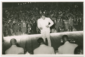 Print of Cab Calloway conducting his band with a large audience visible