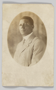 Photographic postcard featuring headshot of a man