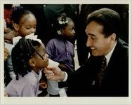 HUD Secretary Henry Cisneros Chats with Sharkease Conway, August 10, 1993