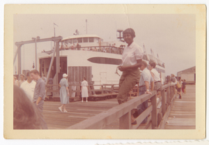 Digital image of a Taylor family woman by a ferry boat on Martha's Vineyard