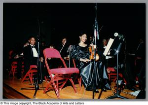 Photograph of some performers in the orchestra ensemble Christmas/Kwanzaa Concert Hallelujah Hip Hop Concert, December 1995