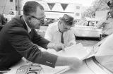 Thumbnail for Public safety commissioner Bull Connor signing payroll on the trunk of a car during the Children's Campaign in Birmingham, Alabama.