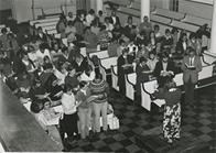 Messiah Sing led by Adel Heinrich. President Strider at right, standing