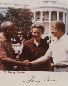 Benny Carter shaking hands with President Jimmy Carter on the White House grounds : color photoprint, autographed