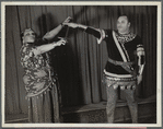 Minto Cato as Azucena and Parker Watkins as Manrico, swearing vengeance on a sword