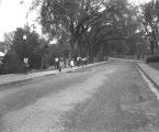 Students walking on campus at Tuskegee Institute in Tuskegee, Alabama.