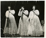 [Triple-image (triple-exposure) picture of Ella Fitzgerald in concert, undated.] [Black-and-white photoprint.]