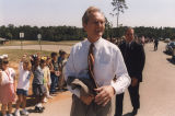 Governor Don Siegelman walking past a long line of children.