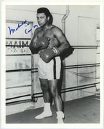 "Muhammad Ali in the boxing ring, autographed ""Muhammad Ali \\ aka \\ Cassius Clay."""