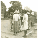 Cotton hoers leaving Greenville at 5 a.m. for a day's work on the plantations; Wages one dollar a day, one dollar and twenty-five cents on a few plantations; Hoers carry their lunches; They return about 8 p.m. Mississippi