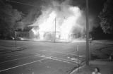 Buildings on fire at the corner of 6th Avenue North and 15th Street North in Birmingham, Alabama, after the bombing of the Gaston Motel.