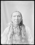 Dakota man, Point At Us Bow. U. S. Indian School, St Louis, Missouri 1904