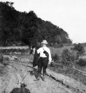 Jackson Davis standing on a dirt road with a walking stick in hand.