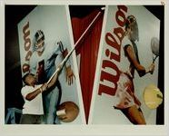 Dexter Baker, of Decatur Touches up Billboards at the Wilson Display at the Super Show at the World Congress Center, February 20, 1991