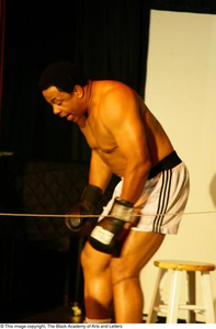 Vincent Cook Performing on Stage Ali...The Man, The Myth, The People's Champion