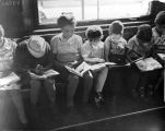 Quincy branch library , Cleveland, Ohio: children reading in window seat.