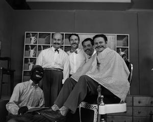 Five men on barbershop set, one in blackface NBC News Photographs