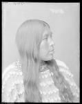 Side view of Wichita Indian woman with elk tooth dress. Oklahoma. Wichita Anadarko. 1904