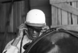 Driver behind a horse inside the stables on the farm of Ernest Oliver in Montgomery, Alabama.