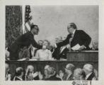 Fifth mayoral inauguration, Richard J. Daley shaking hands with Joseph Bertrand