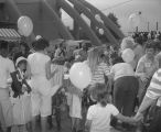 Children and adults in front of Garrett Coliseum during the 1985 South Alabama Fair in Montgomery, Alabama, for an event sponsored by McDonald's.