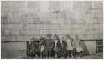 Group portrait of Howard Orphanage and Industrial School children sitting on bench