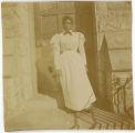 Maid on steps of Merion Hall