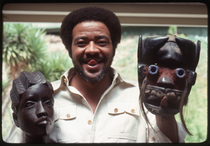 Thumbnail for Bill Withers: Withers posing with an African bust and mask