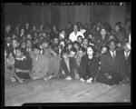 Negro Nite Life on Central Avenue..Series, Group of African American clubgoers in front of stage in Los Angeles, Calif., 1938