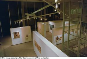 Aerial view of sculptures and paintings on display in gallery Reggae in the Caribbean