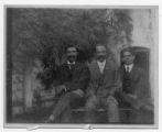 William Hunton, Jesse Moorland, and George Haynes in Moorland's back yard, 1907