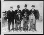 [Abe Rachlin (prospect from Newark), Ad Brennan, Jim Moroney, Frank Scanlan, & three Afro-American boys who were mascots (baseball)]