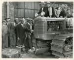 Photo of Men Inspecting a Tractor