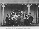 A group of officers and teachers